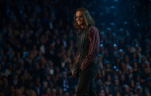 Johnny Depp walks on the stage at the Staples Center during the 55th Grammy Awards in Los Angeles.