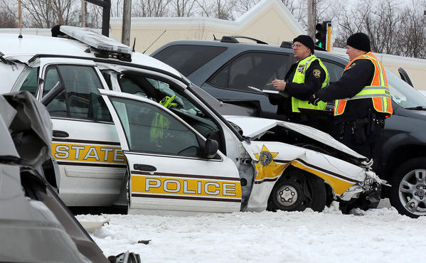 Traffic crash investigators study the scene of a the five-vehicle crash in Wheaton.