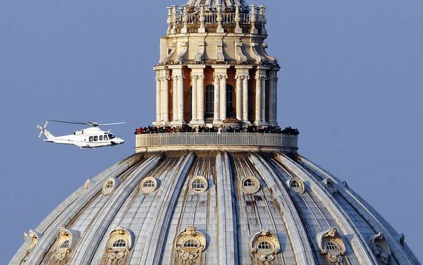 A helicopter carrying Pope Benedict XVI takes off from inside the Vatican on its way to the papal summer residence at Castel Gandolfo.