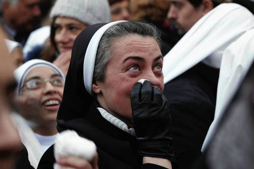 A nun becomes emotional as Pope Benedict XVI waves to pilgrims for the last time as head of the Catholic Church, from the window of Castel Gandolfo where he will start his retirement in Castel Gandolfo, Italy.