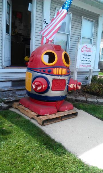 The robot greets customers at Chicago Computers of Naperville, 639 S. Washington St.
