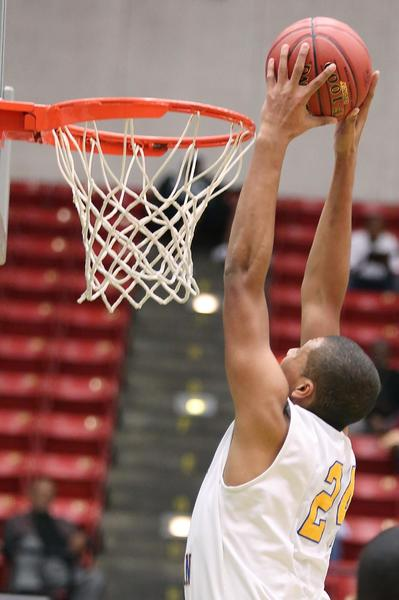 Orlando Christian Prep's Brandon Miller goes up for a slam dunk during the Class 2A FHSAA Boys Basketball State championship game of Orlando Christian Prep versus Grandview Prep at the Lakeland Center on Wednesday, February 27, 2013.
