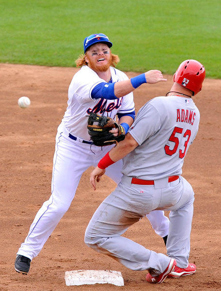 New York Mets second baseman Justin Turner (left) turns a double play over St. Louis Cardinals first baseman Matt Adams (53) during the game at Tradition Field. The Cardinals defeated the Mets 12-4.