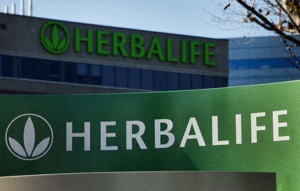 Herbalife shares rose after a deal was made with billionaire investor Carl Icahn.