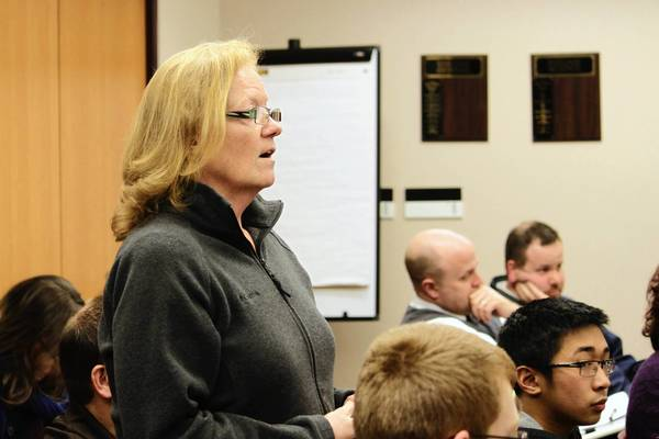 Plainfield resident Jane Ellingsworth questions why Plainfield Community Unit School District 202 board members denied administrative salary increases at the Feb. 25 meeting.