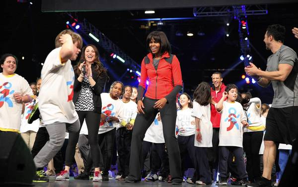 Schoolkids dance with Michelle Obama.
