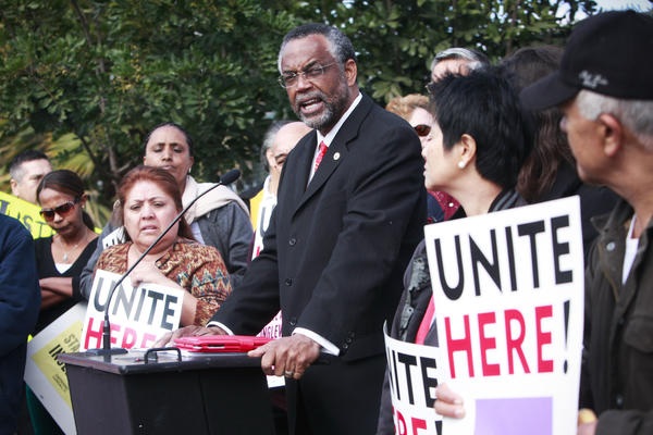 Sen. Curren Price Jr. speaks in February with workers gathered to protest the coming layoffs of about 150 people from the Hollywood Park Casino.