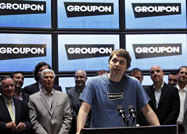 Groupon CEO Andrew Mason speaks as Mayor Richard Daley announces a new committee on technology infrastructure in 2010 at Groupon's headquarters.