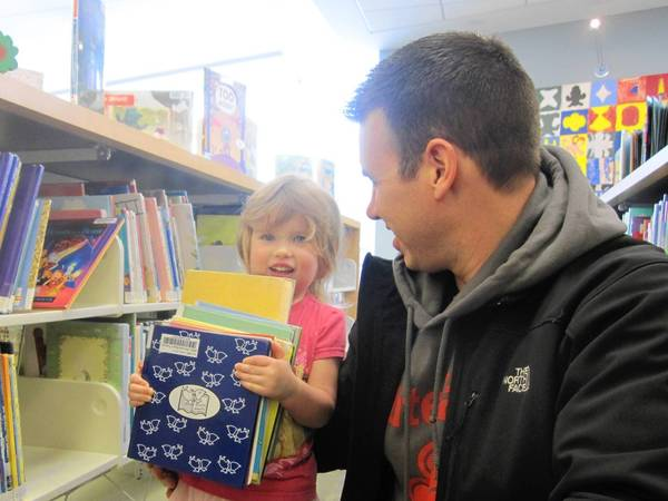 Jon Twitty and daughter Grace, 3, visit the Orland Park Public Library Friday. The library is getting ready to launch a new catalog system in April.