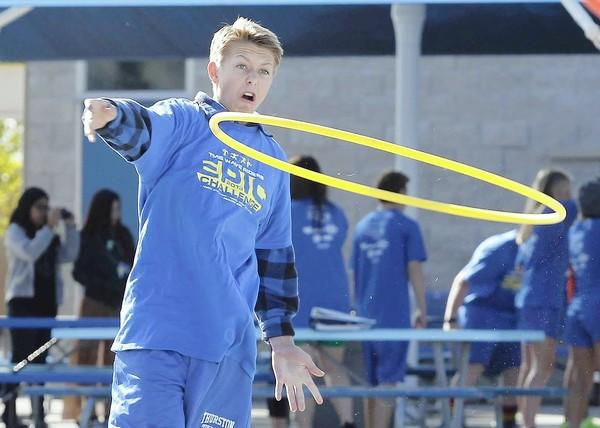 Ashton Goddard hurls a hula hoop onto a traffic cone during the Epic Challenge at Thurston MIddle School on Wednesday.