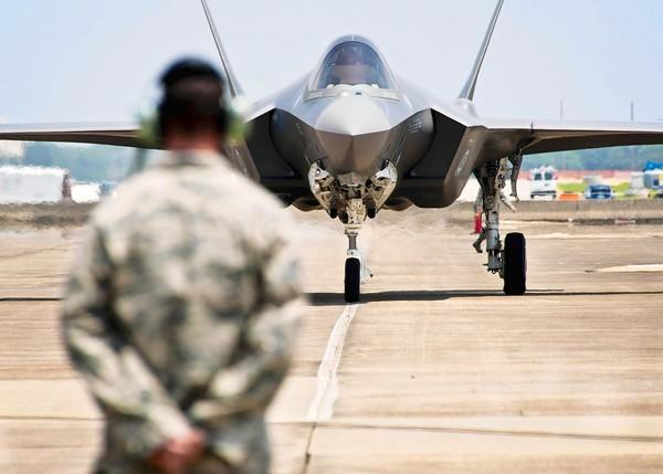 Defense budget experts say that an alternative to across-the-board spending cuts is scaling back production of some military hardware, such as the F-35 fighter jet, above.