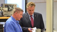 With a notebook in hand, Democrat Terry McAuliffe took in the mechatronics lab at Virginia Western Community College. Like other campaigns that have visited the automated assembly line before him, McAuliffe was focusing on workforce development, and the jobs that can flow from advanced training.
