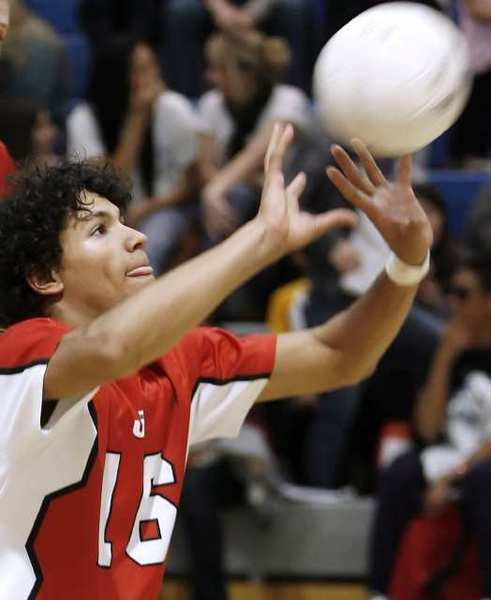 ARCHIVE PHOTO: Burroughs High School's Daniel Jacobs receives one during away game vs. Burbank High School at BHS in Burbank on Tuesday, March 13, 2012.