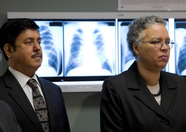 Cook County Board President Toni Preckwinkle, right, and Dr. Ram Raju, CEO of the county's health and hospitals system, meet with the media at Stroger Hospital on Thursday, a day before the county's $1-a-pack cigarette tax increase takes effect.