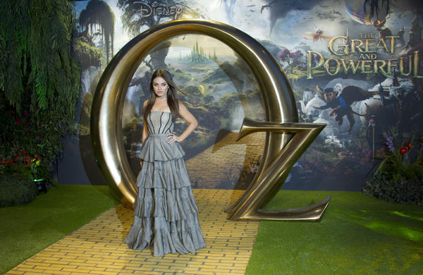 "Actress Mila Kunis arrives at the London premiere of ""Oz The Great And Powerful"" on Thursday."