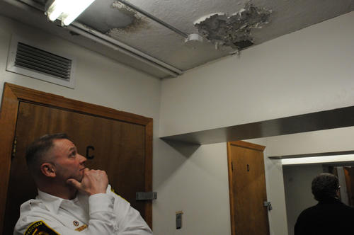 Assistant fire chief William Provencher looks at water damage on the ceiling at the Thompsonville fire station Tuesday.