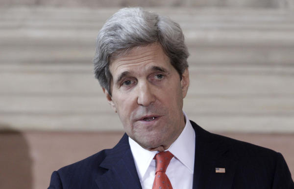 Secretary of State John Kerry gives a statement during a press conference following an international conference on Syria at Villa Madama, Rome.