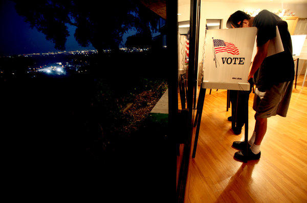 A voter is seen casting his ballot at a polling site in South Pasadena.