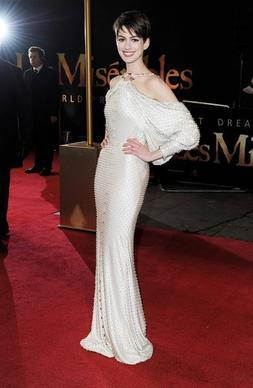 "Anne Hathaway in a Givenchy pearl-studded halter gown at the London premiere of ""Les Miserables."""