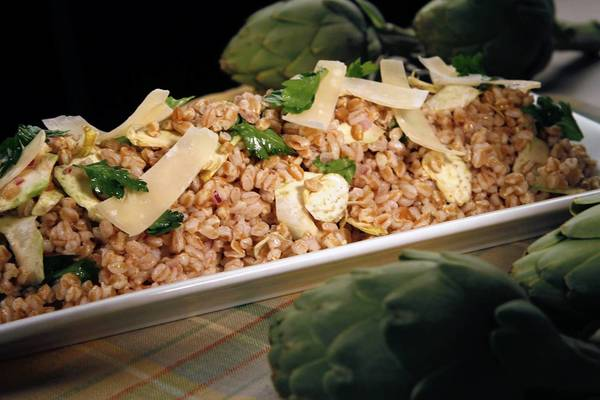 Artichoke and farro salad is topped with Parmigiano-Reggiano.