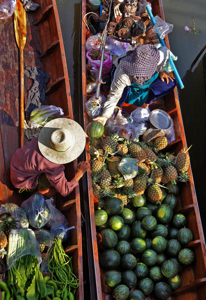 Produce is hawked at a floating market in Bangkok, Thailand, where phases of the moon affect opening days of some traditional markets.