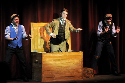 "Mr. William Cartwright, Your Chairman portrayed by Connor McInerney (center) performs the opening act ""There You Are""  during the Mystery of Edwin Drood."