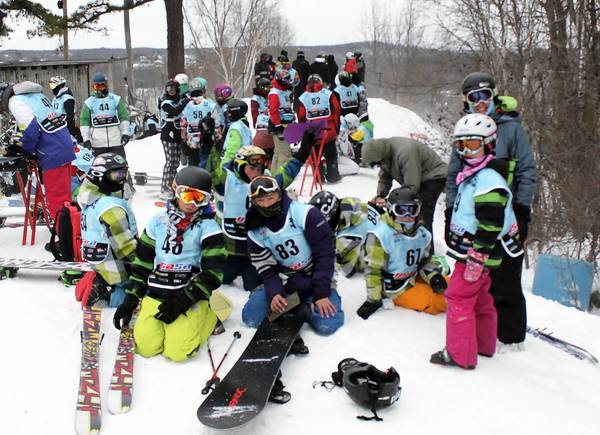 Members of the Blue Mountain Freeriders competition team from Blue Mountain Ski Area in Palmerton take a break atop the Boarder-Cross course during a recent competition at Ski Ward in Massachuestts.