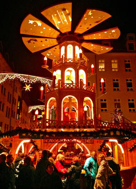 Shoppers pack the Christmas Market, an annual celebration of the holiday season in Dresden, Germany.