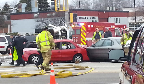 Emergency personnel at the scene of a fatal accident at Dundee and Skokie roads in Northbrook this afternoon.