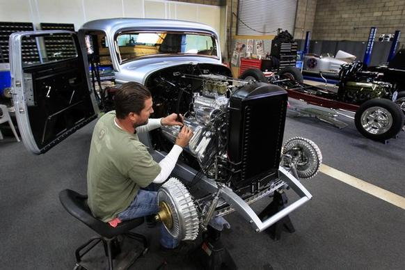 Jimmy Shine, shop manager at So-Cal Speed Shop, works on a 1932 Ford  owned by Bill Lindig of Houston, which Shine was preparing for display at the 64th Grand National Roadster Show at the Fairplex in Pomona. So-Cal Speed Shop is one of the Southland's oldest hot rod garages.
