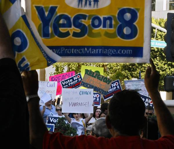 Opposing groups face off in November 2008 over California's Proposition 8, which banned same-sex marriage in the state. The Obama administration is urging the Supreme Court to strike down Proposition 8.
