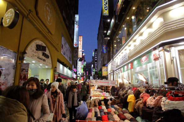 "Can 11.1 million tourists, mostly Chinese and Japanese, be wrong? South Korea doesn't think so. That was the country's tourist total in 2012 ¿ a record. Probably the Korean singer Psy's YouTube hit ""Gangnam Style"" didn't hurt. (Gangnam is a posh, modern shopping area in the capital that one British journalist has called ""the Mayfair of Seoul."") American tourists arrive in a trickle, not a torrent, but the country is poised for tourism growth. Many infrastructure improvements were made for the 2012 World Expo in Yeosu, about 31/2 hours south of Seoul by high-speed rail. Besides the green mountains that surround Seoul and the hubbub of the city itself, there's a 3.6-mile stream running through town. It's called Cheonggyecheon, and it's part of a linear park with a tranquil walking path that opened in 2005. Elsewhere, visitors can take the Dolsan Bridge to verdant Dolsan Island, explore the Itaewon night-life district or Bukchon Hanok Village (a collection of traditional wooden homes near the Gyeongbok and Changdeok palaces) and browse the big department stores (Shinsegae, Lotte and Hyundai are three)."
