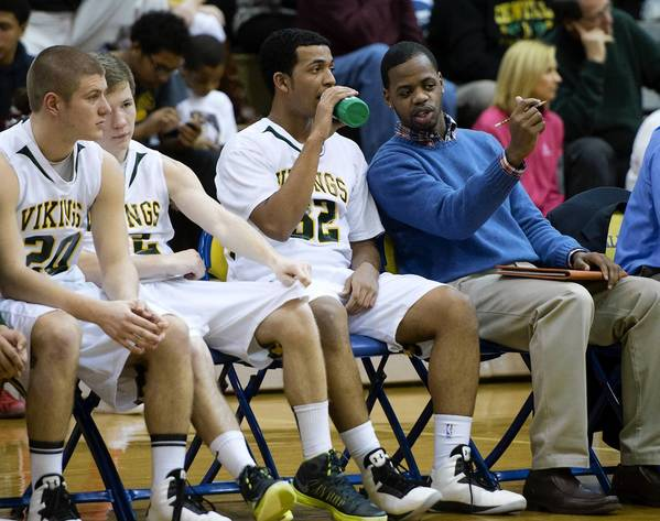 Central Catholic HIgh School assistant coach Darnell Braswell talks to players during a District 11 AAA boys basketball semifinal game at Allen High School on Tuesday.