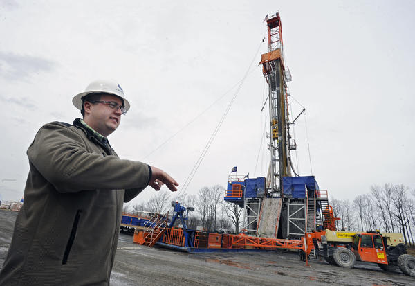Bill Desrosiers, of Cabot Oil & Gas, describes a drill rig that drills for natural gas wells.