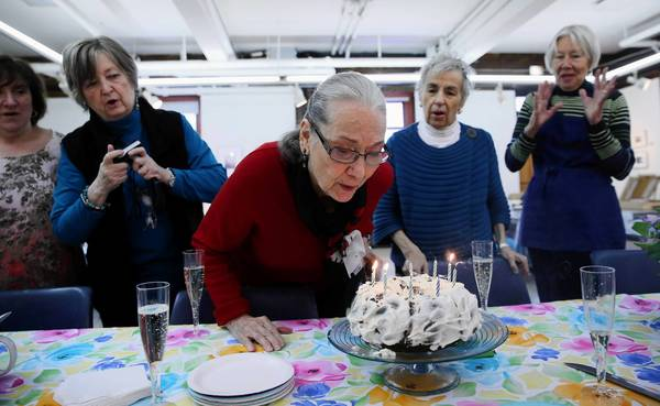 Kay Smith celebrates her 90th birthday with her friends and watercolor students Thursday at the Old Town Triangle Art Center.
