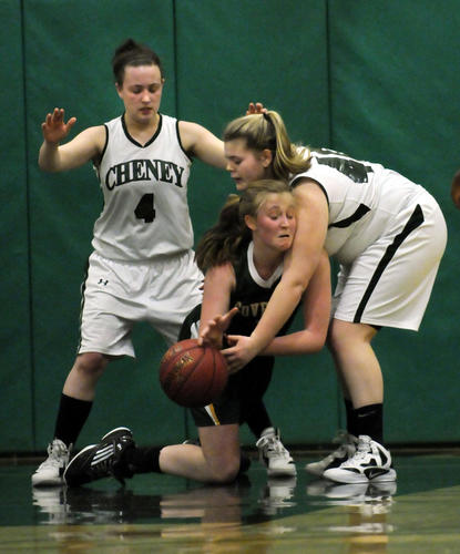 In a very physical second half, Coventry's Claire Hall loses the ball to Cheney's Jaclyn Ellis. At left is Sierra Dockum of Cheney. Cheney Tech won, 56-50.