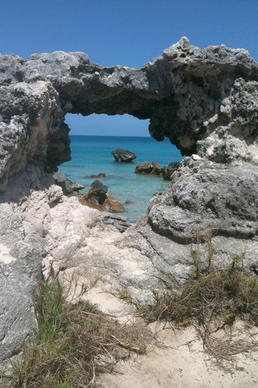 Tobacco Bay in Bermuda's St. George's parish features several coral rock formations and aquamarine waters.
