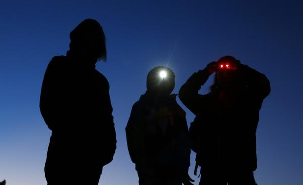 hree boys await the arrival of Unidentified Flying Object (UFO) hunter Kim Carlsberg of UFO Sky Tours to begin their search outside Sedona, Arizona, as darkness falls in the desert.