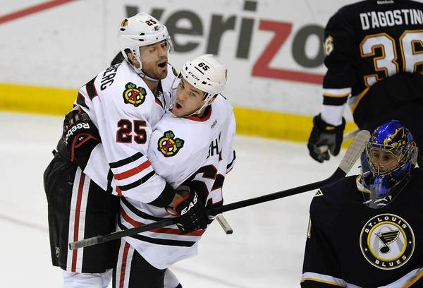 Andrew Shaw is congratulated by Viktor Stalberg after scoring a goal on Blues goalie Jaroslav Halak in the third period.
