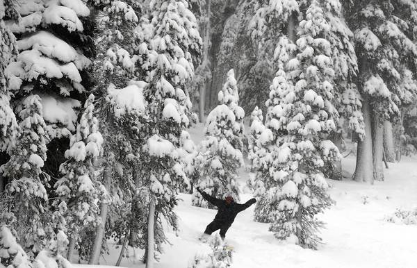 A snowboarder enjoys the fruits of a winter storm at Mammoth Mountain. A study suggests that dust particles blown from Asian and African deserts can boost rain and snow amounts in California's mountains.