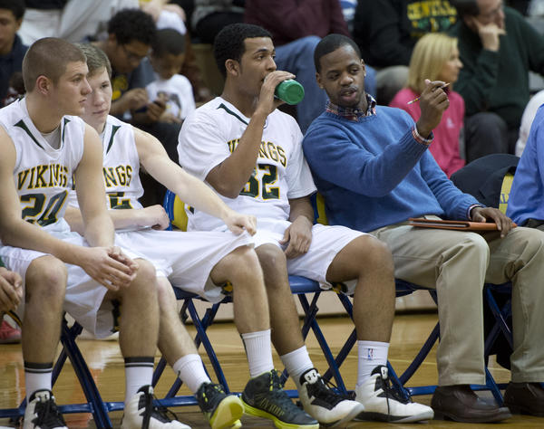 Central Catholic HIgh School assistant coach Darnell Braswell, talks to players during a District 11 AAA boys basketball semifinal game at Allen High School on Tuesday.