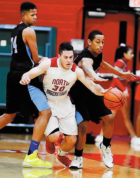 North Hagerstown's Andrew Yacyk (30) gets caught between Einstein's Joe Bradshaw, left, and Teddy Kassa in the first quarter of Thursday's Maryland Class 3A West quarterfinal game at North.