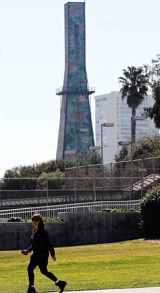A decorative exterior masks an oil rig on Olympic Boulevard in Beverly Hills next to Beverly Hills High.