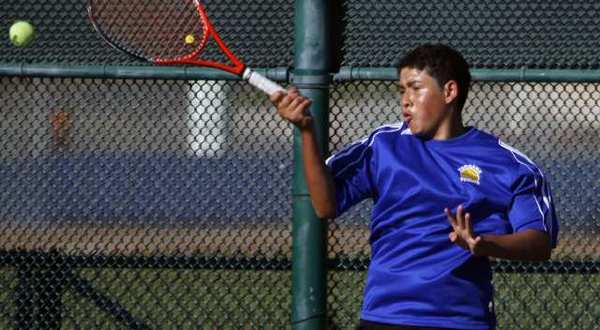 Burbank's Kevin Orellana plays against Artiom Ambatsoumian during a singles match at Burbank High.