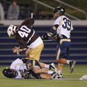 Lehigh's Ty Souders (40) Navy's Sam Jones (on ground) and Tucker Hull