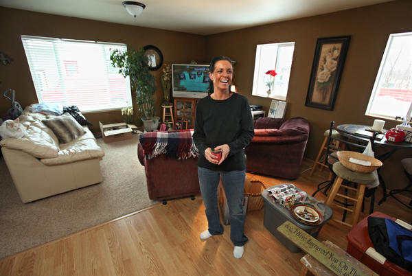 Tammy Knoll of Aberdeen still has some unpacking to do in her new Governor's Home.