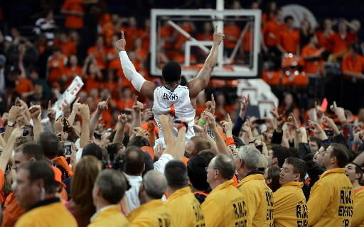 Virginia fans hoist Jontel Evans after victory over Duke.