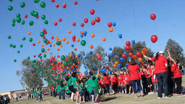 Kindergartners through third-grade students release balloons to start the McCabe Primary Olympics at McCabe Elementary School in El Centro on Thursday.