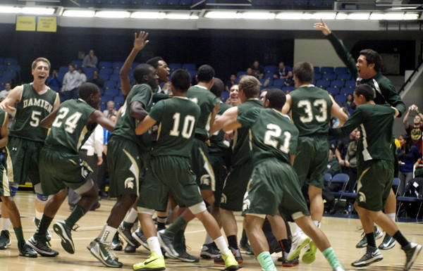 Damien players celebrate winning the Southern Section Division 3AA title on Thursday night in Anaheim.