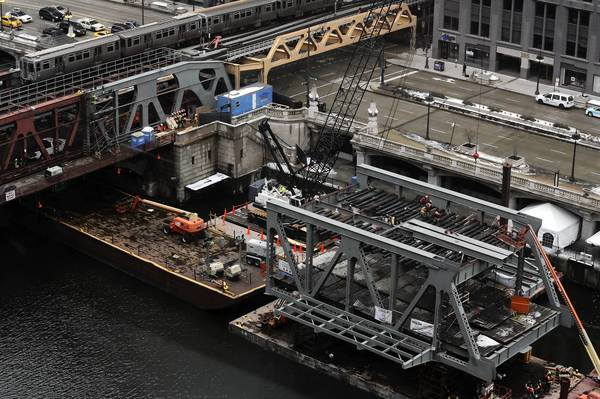 Ironworkers make preparations Thursday for a project to replace the southern portion of the Wells Street Bridge.